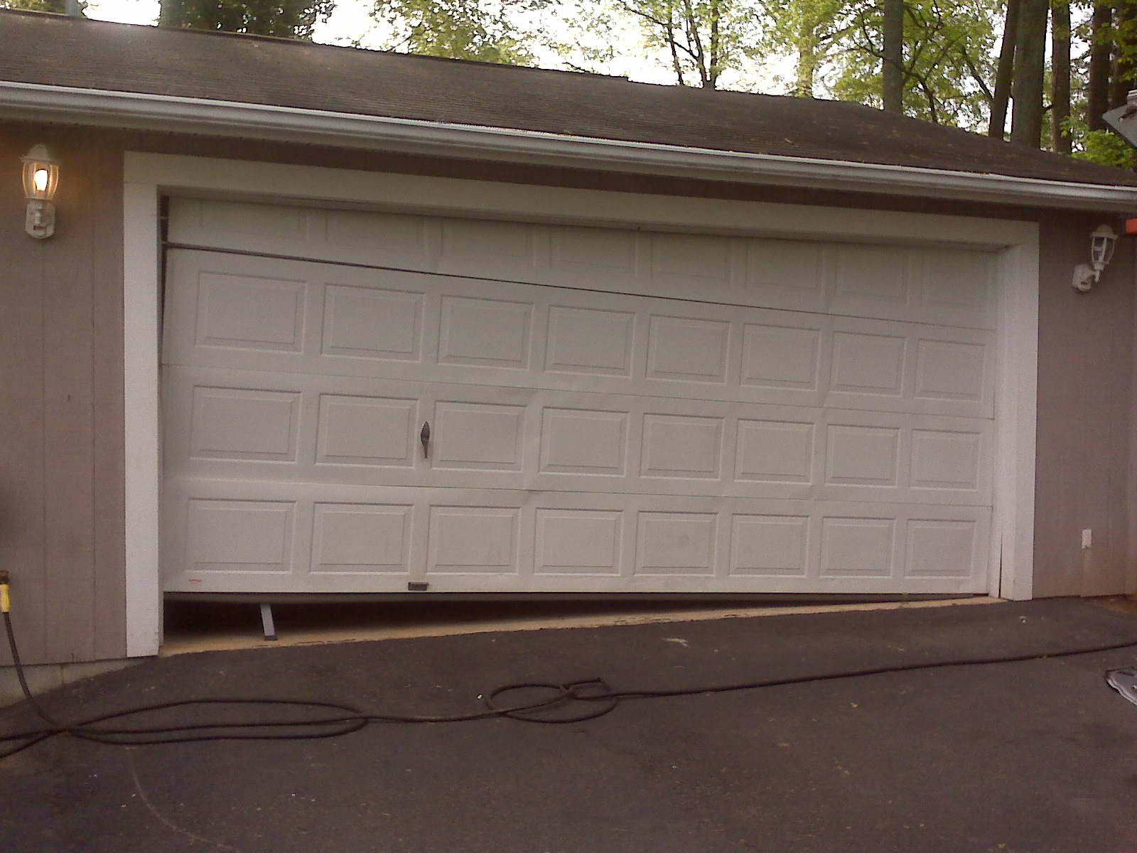 Broken garage door 2 a plus garage doors for 2 door garage door