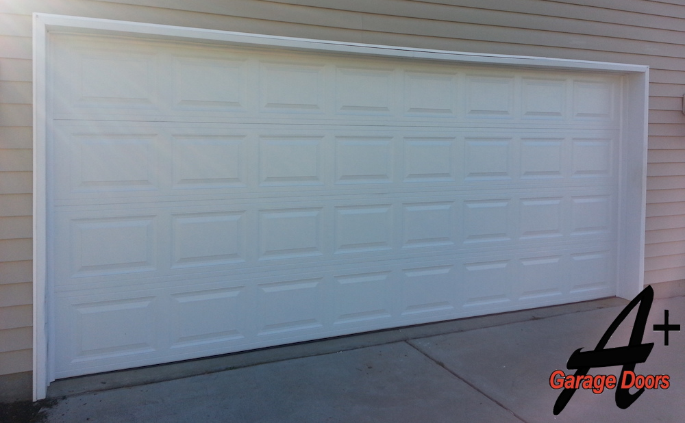 Two Car White Residential Garage Door Installation