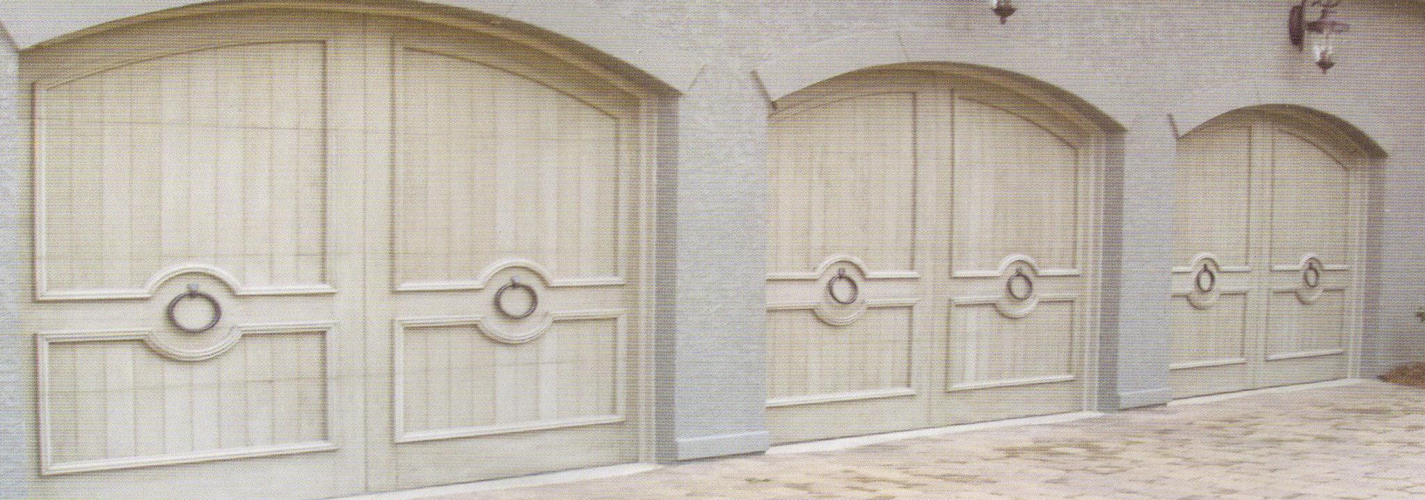 Residential garage door installations custom wood charlotte for Composite wood garage doors