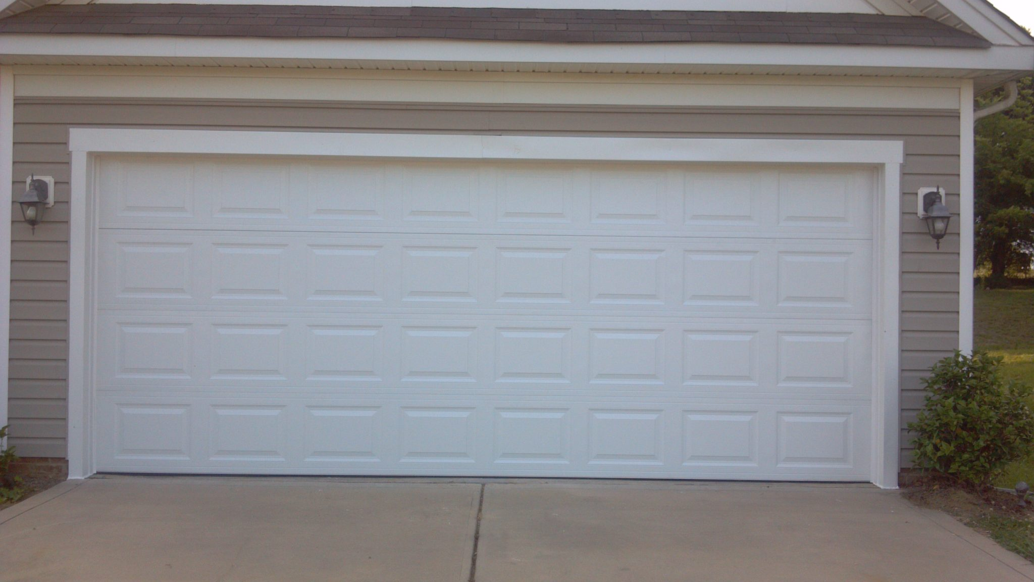 Two single garage doors made into one garage door after for Convert two door garage into one