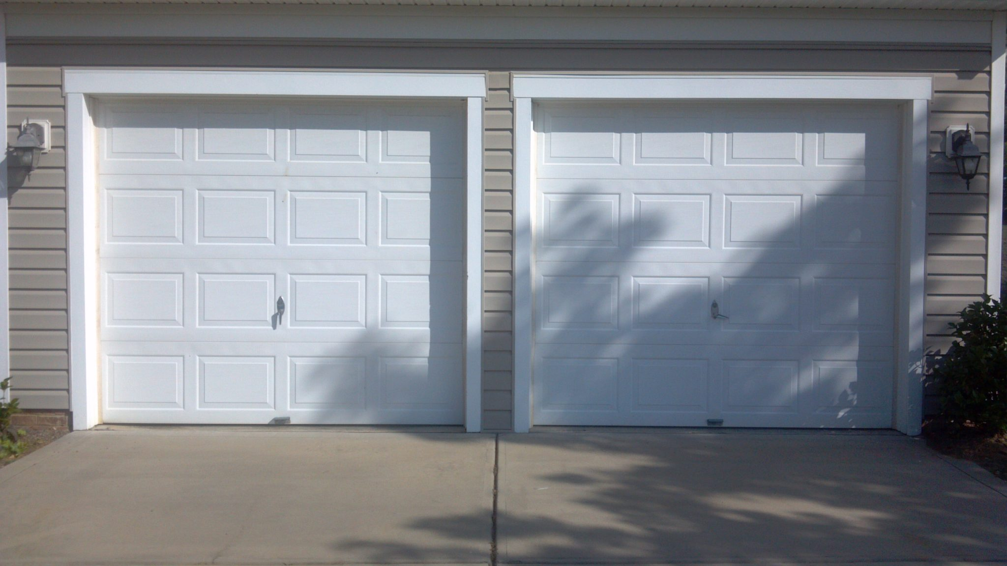 two single garage doors before a plus garage doors