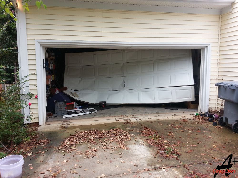 Residential Garage Door Broken Hit by Car Damaged