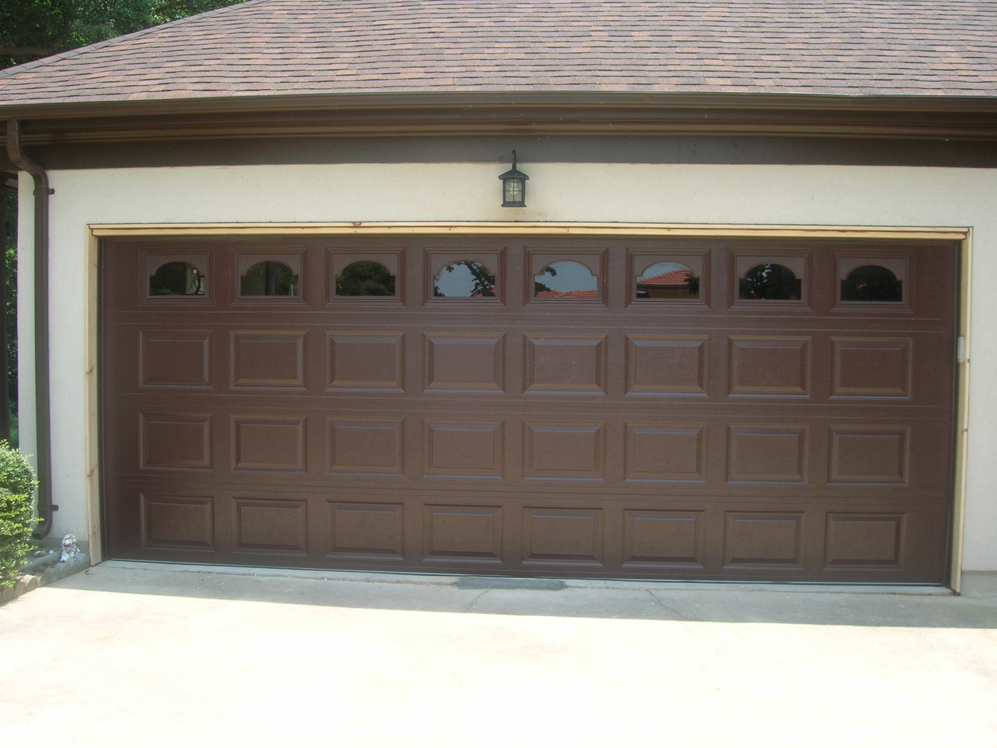 double garage door a plus garage doors. Black Bedroom Furniture Sets. Home Design Ideas