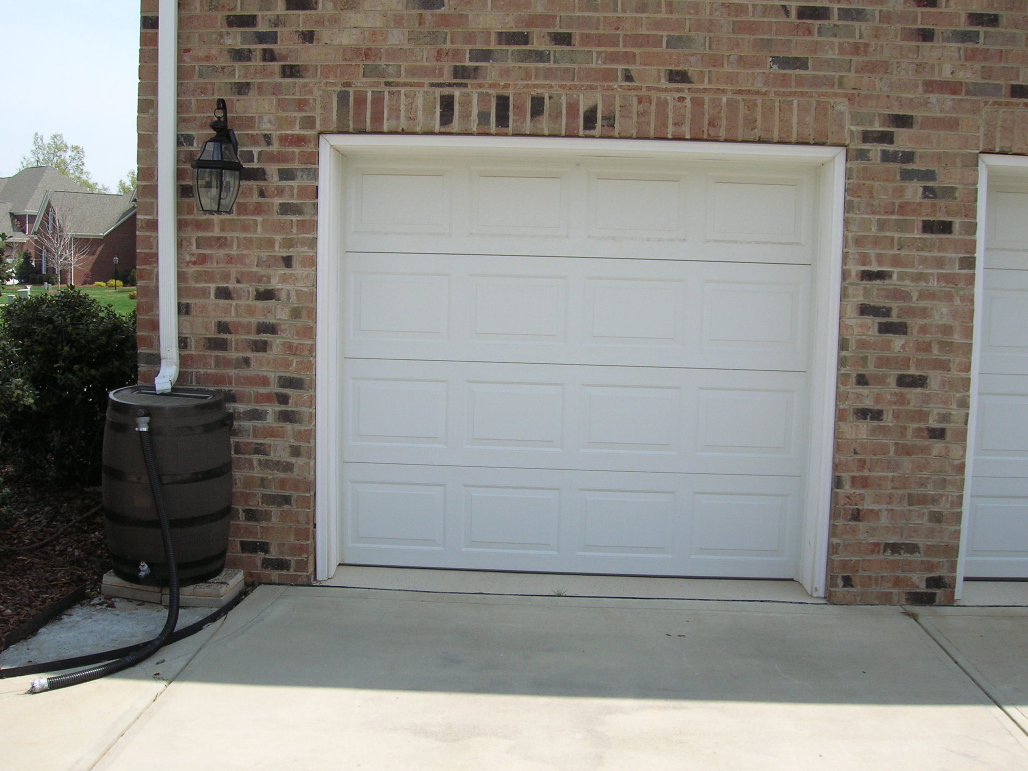 Single garage door stallings nc a plus garage doors for How wide is a single car garage door