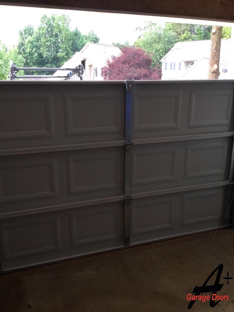 Residential garage door installation replacement step by for Charlotte garage door repair